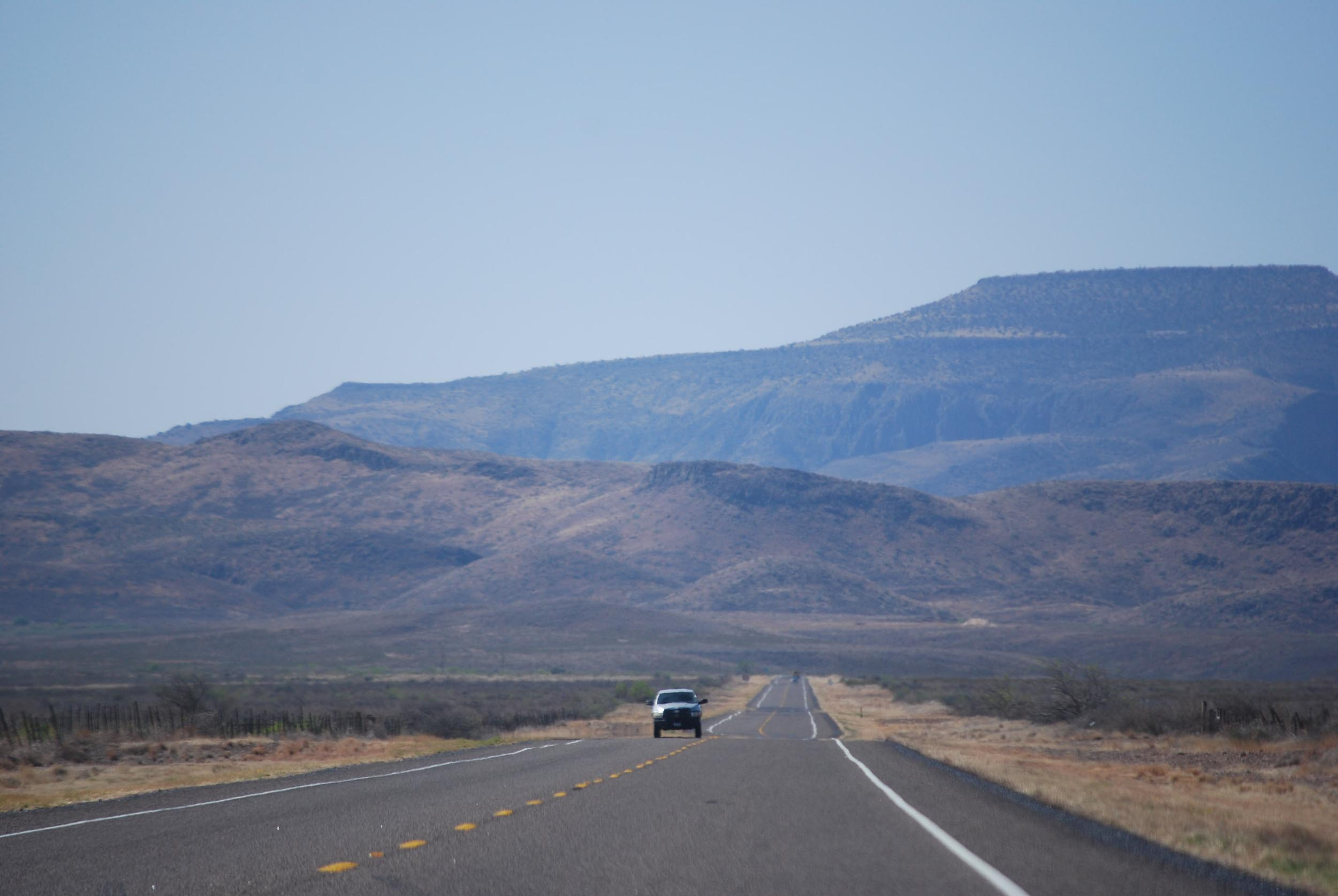 Carousel photo for Zach Doty's digital marketing website. Photo is of a highway in Texas' Davis Mountains.